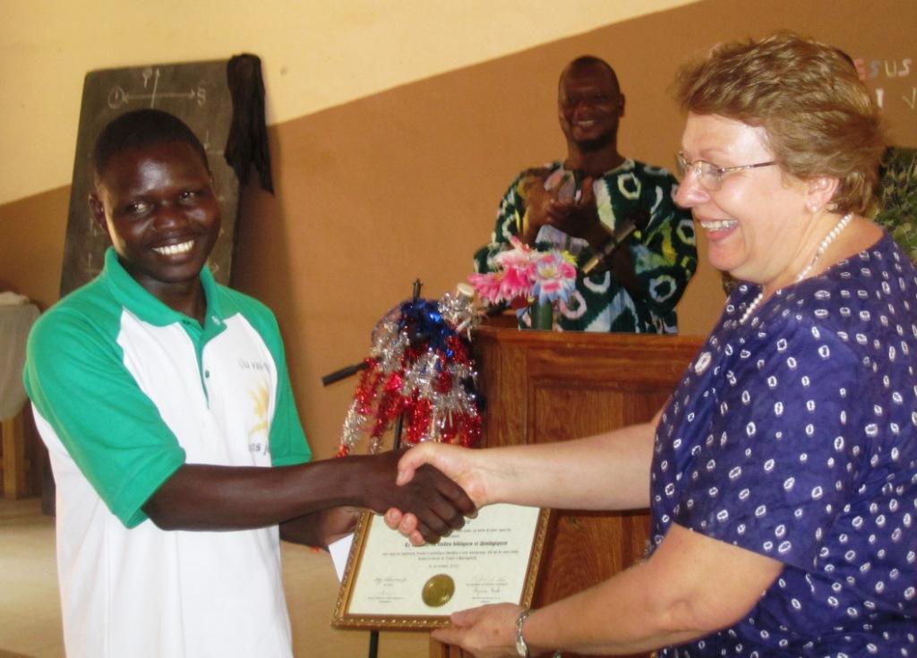 Pastor Enoc gets his GU Certificate